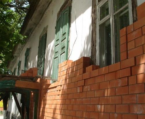 как обложить фасад дома кирпичом